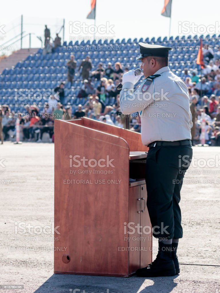 Ensign of the Israel Defense Forces  in ceremonial form delivers a speech from the rostrum at the evening formation in Nahariya, Israel stock photo