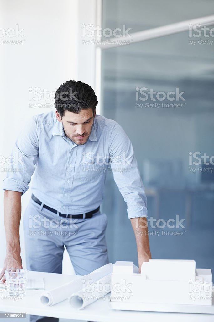 Ensuring everything is as it should be before his presentation royalty-free stock photo