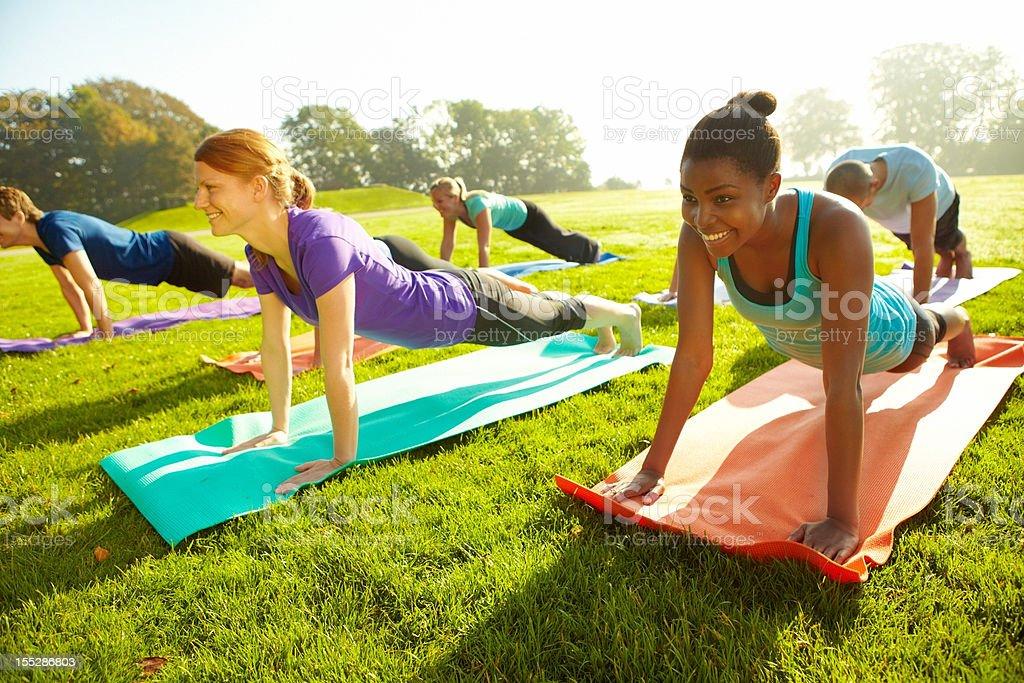 Ensuring tight bodies - Yoga royalty-free stock photo
