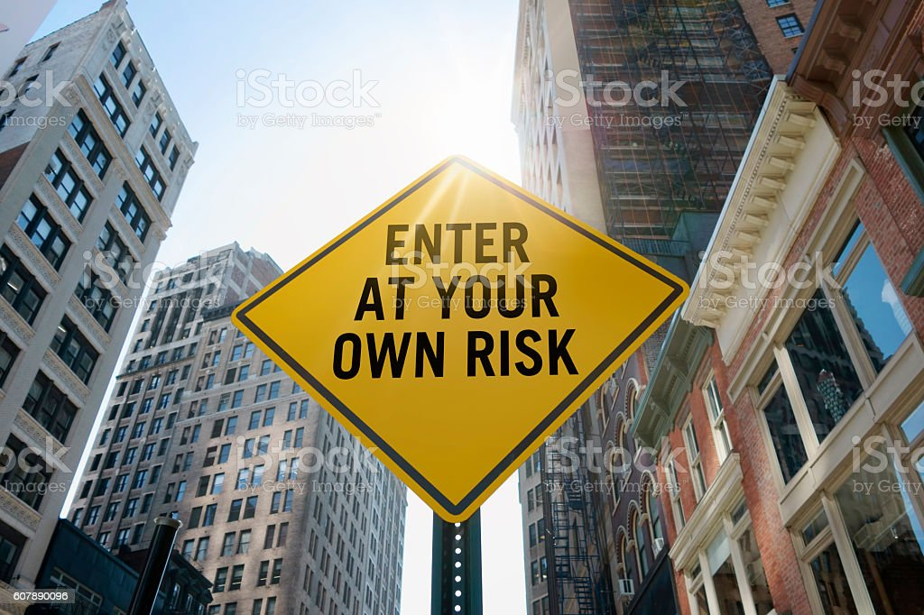 'enter at your own risk'traffic sign stock photo