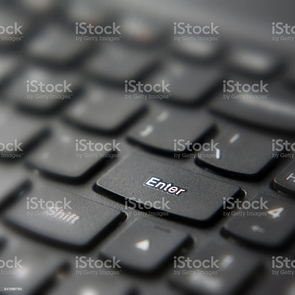 Enter keyboard button in low key stock photo