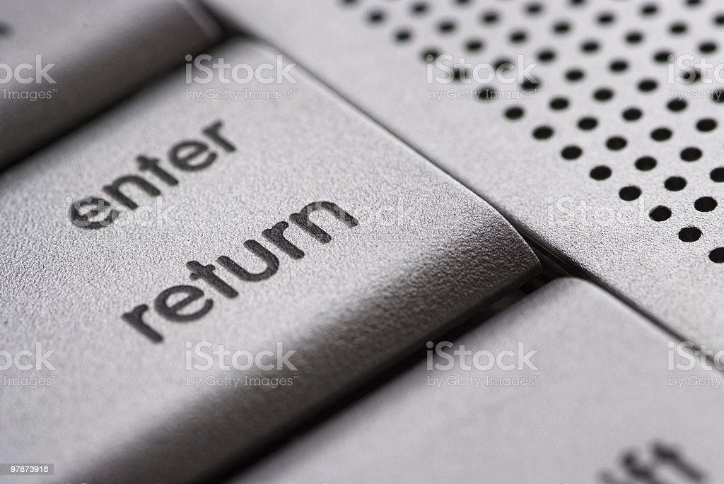 enter / return button on a silver laptop royalty-free stock photo