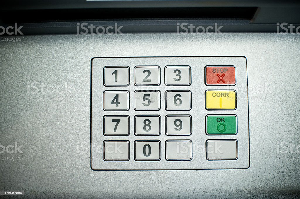 enter security code at ATM stock photo