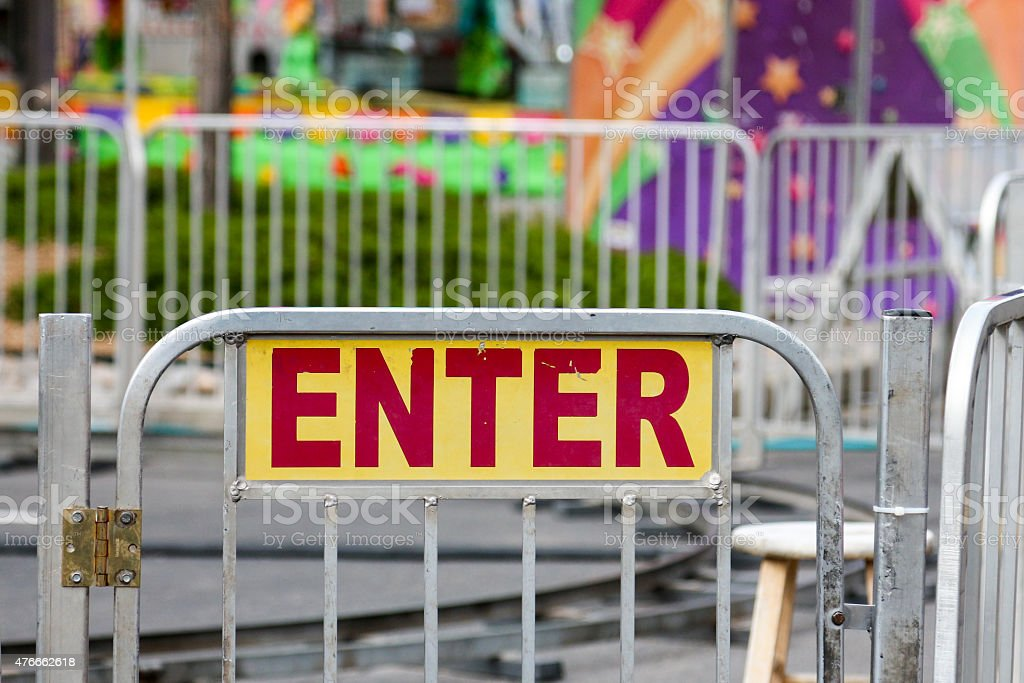 Enter sign on a carnival ride gate stock photo