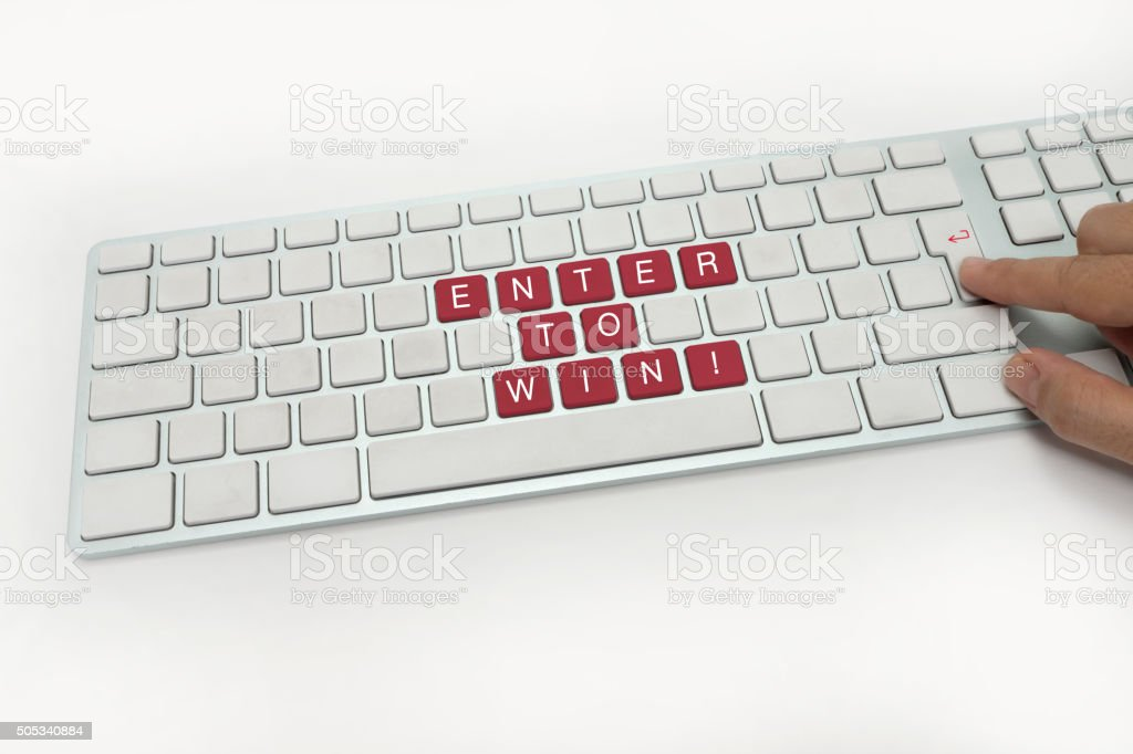 Enter to Win Concept on Keyboard stock photo