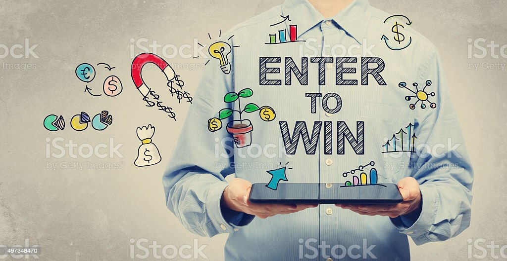 Enter to Win concept with man holding a tablet stock photo