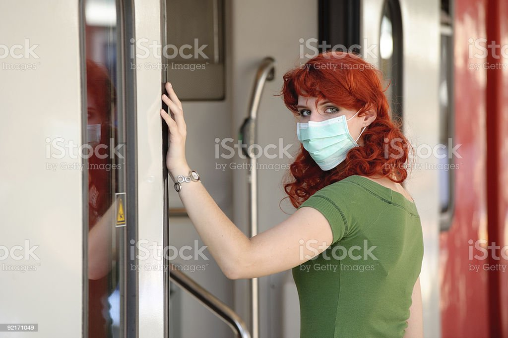 Enter train with face mask royalty-free stock photo