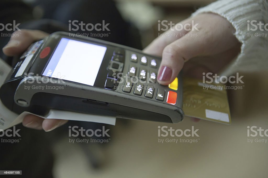 Enterin PIN on Credit card reader stock photo