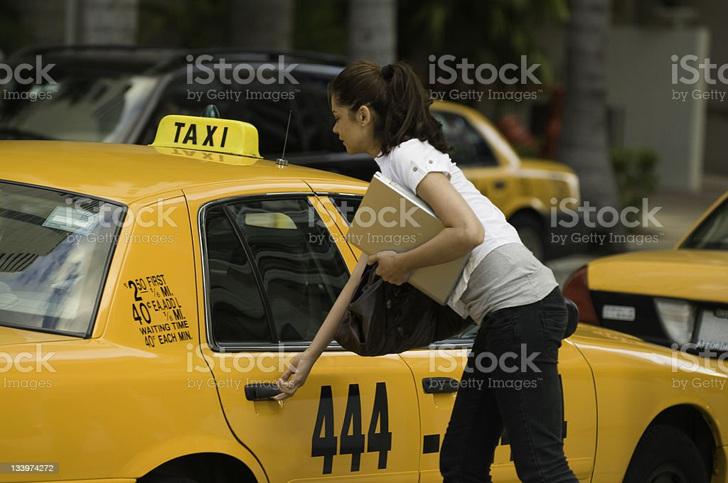 Entering a cab royalty-free stock photo