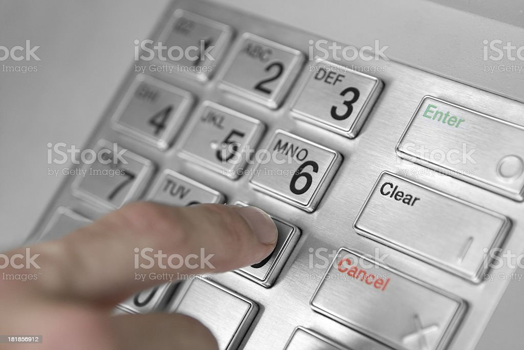 Entering Code at ATM bank machine royalty-free stock photo