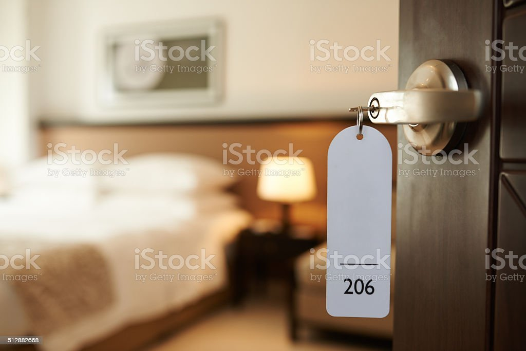 Entering hotel room stock photo