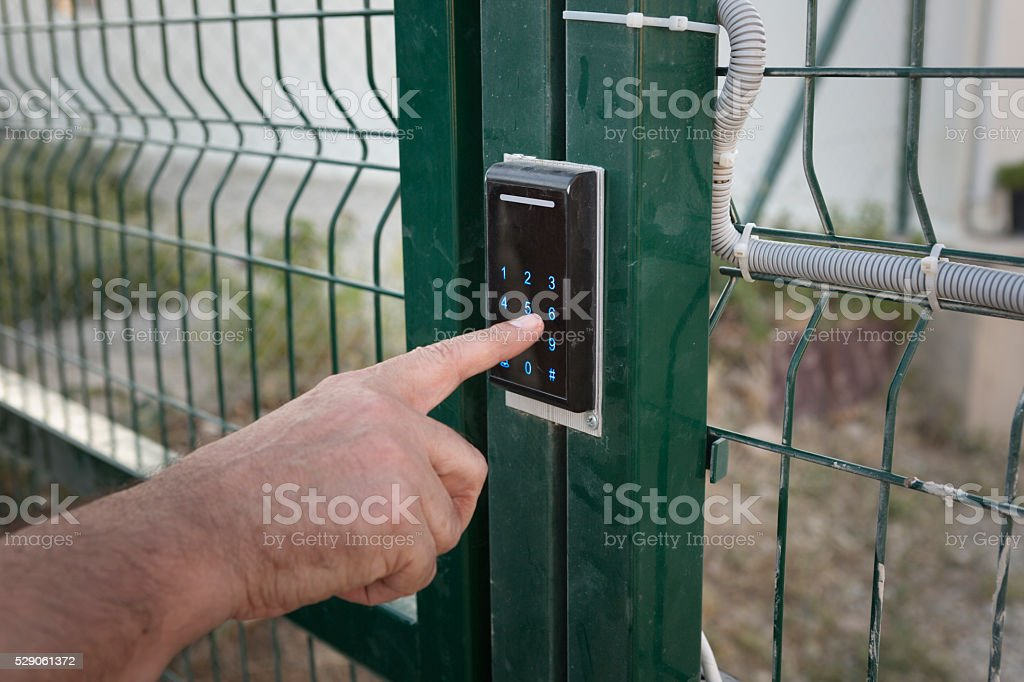 Entering Passcode of a Garden Door stock photo