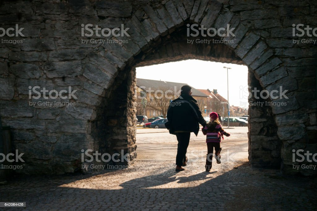 Entering the walled village stock photo