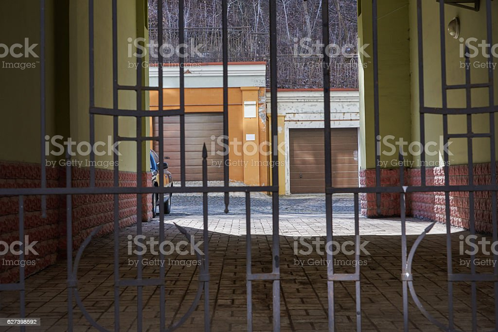Entering the yard is closed metal openwork gate royalty-free stock photo