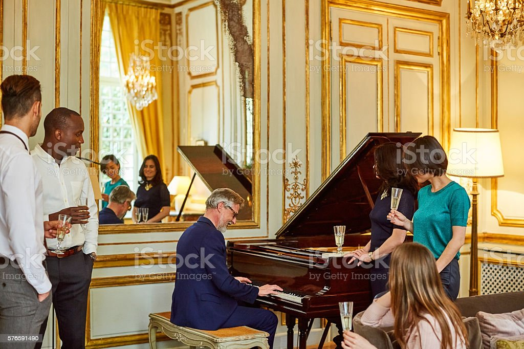 Entertaining with a tune on the piano stock photo