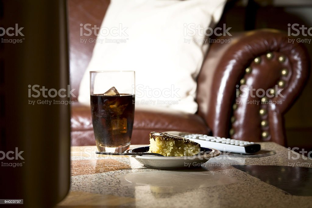 Entertainment: Coke and cake snack table in front of television stock photo