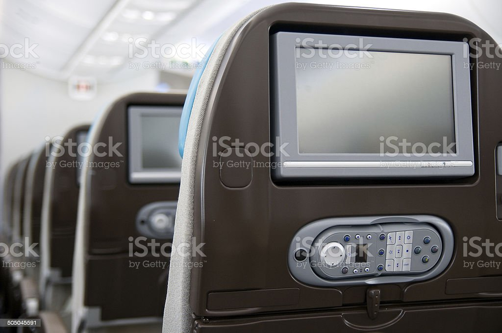 Entertainment system onboard airliner stock photo
