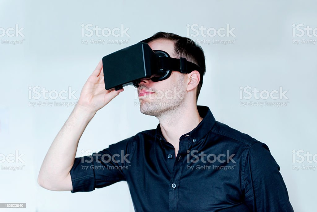 Entertainment with a pair of virtual Reality glasses stock photo