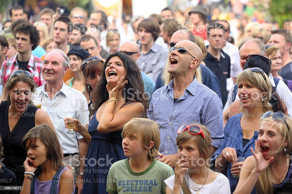 Enthusiastic audience enjoying a pop concert of 'Gentse Feesten' stock photo