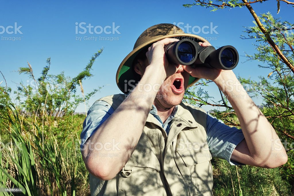 Enthusiastic Bird Watcher on Safari royalty-free stock photo