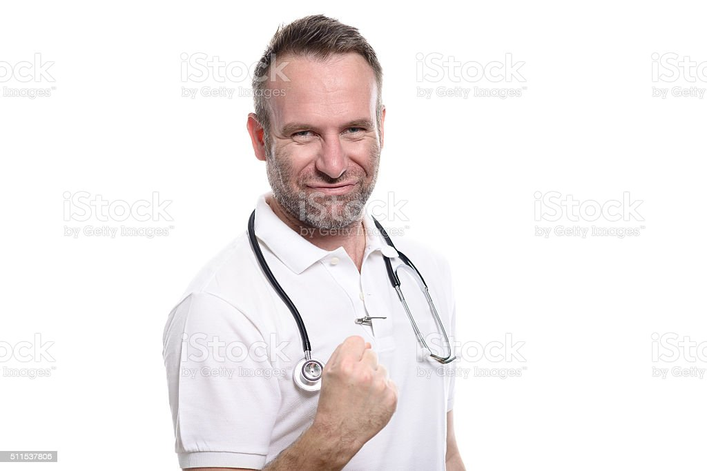 Enthusiastic doctor punching the air stock photo
