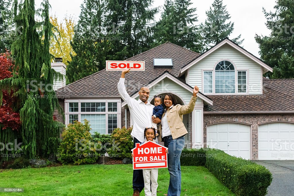 Enthusiastic Family with Home For Sale stock photo