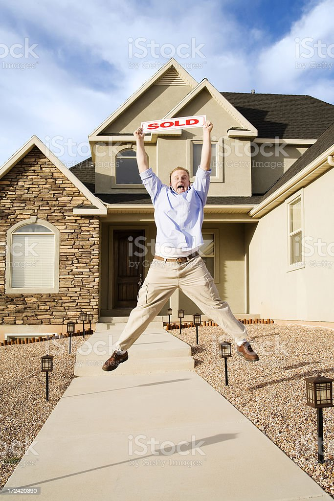 Enthusiastic Home Owner with Sold Sign royalty-free stock photo
