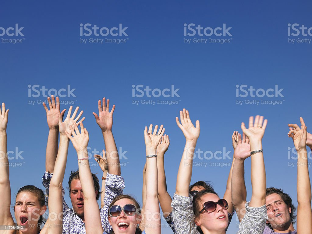 Enthusiastic People with Arms Raised royalty-free stock photo