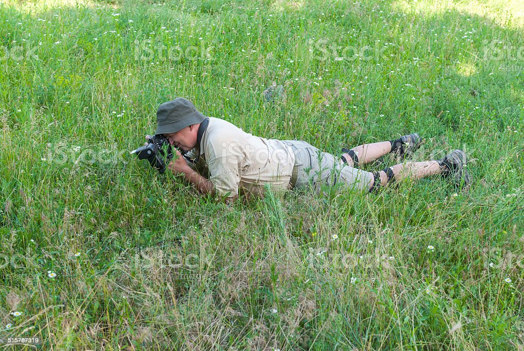 Enthusiastic photographer on a spring meadow. stock photo
