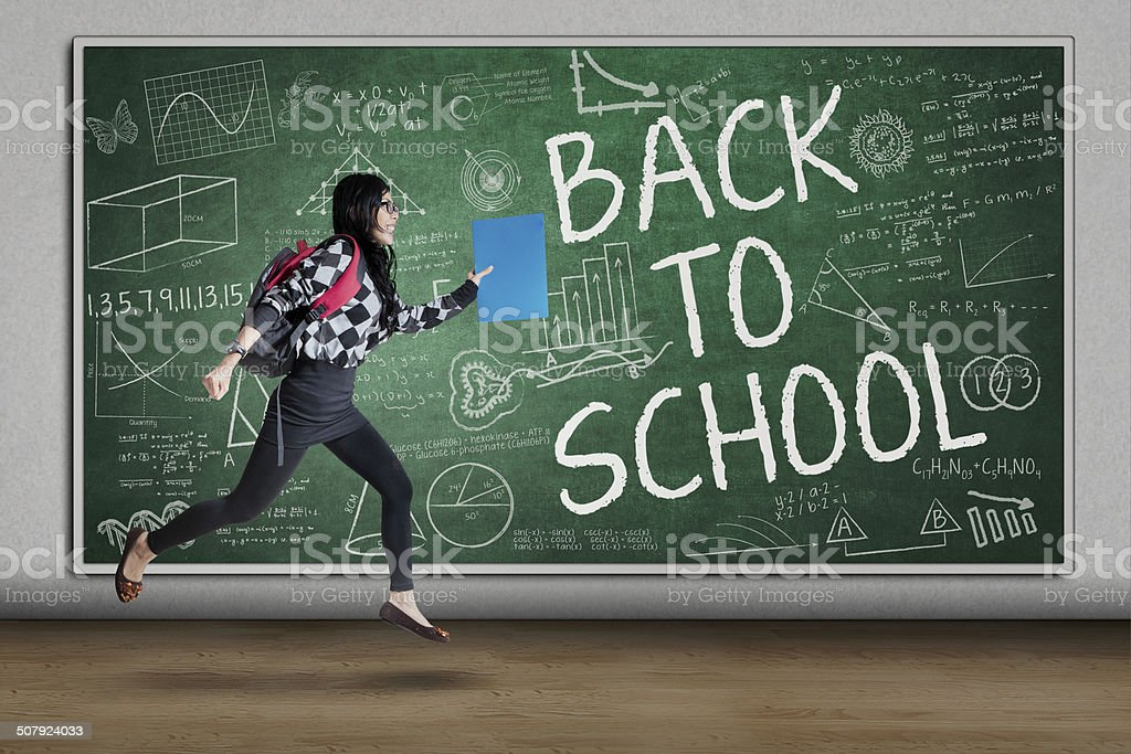 Enthusiastic student to school stock photo