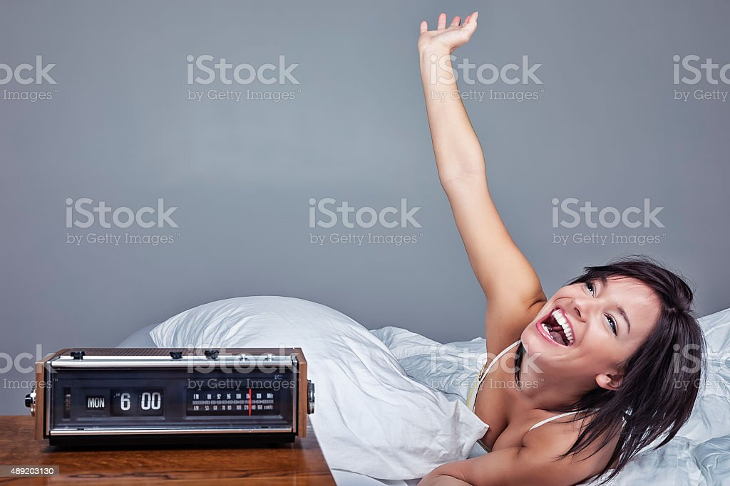 Enthusiastic Woman Waking Up on Monday Morning stock photo