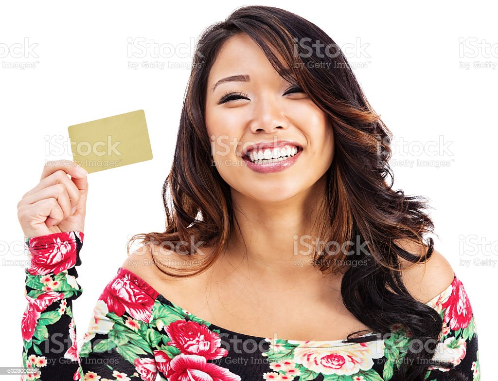 Enthusiastic Young Asian Woman with Gold Credit Card stock photo
