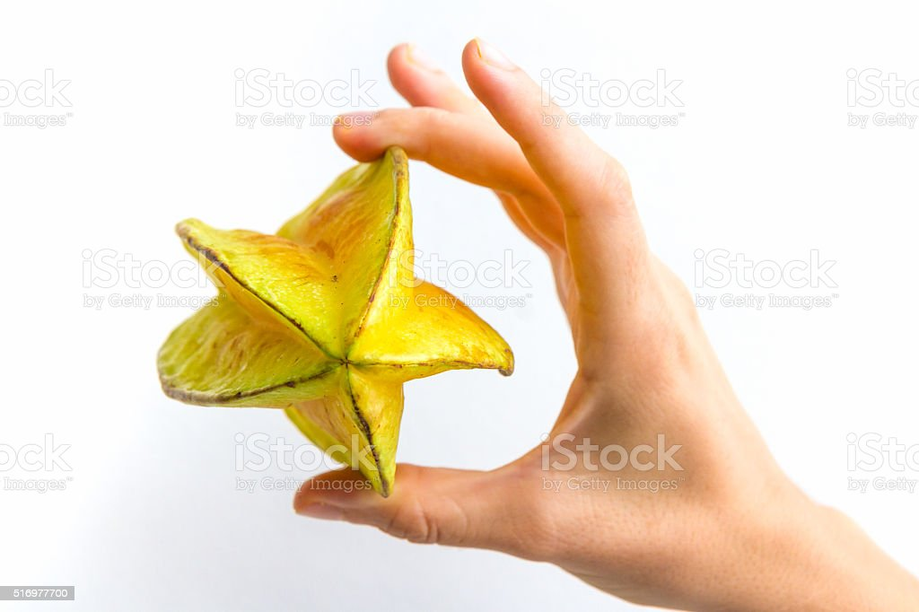Entire Starfruit in Hand stock photo