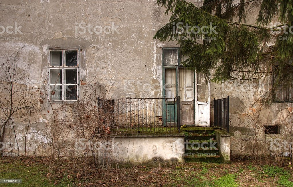 Entrance area of an abandoned house stock photo