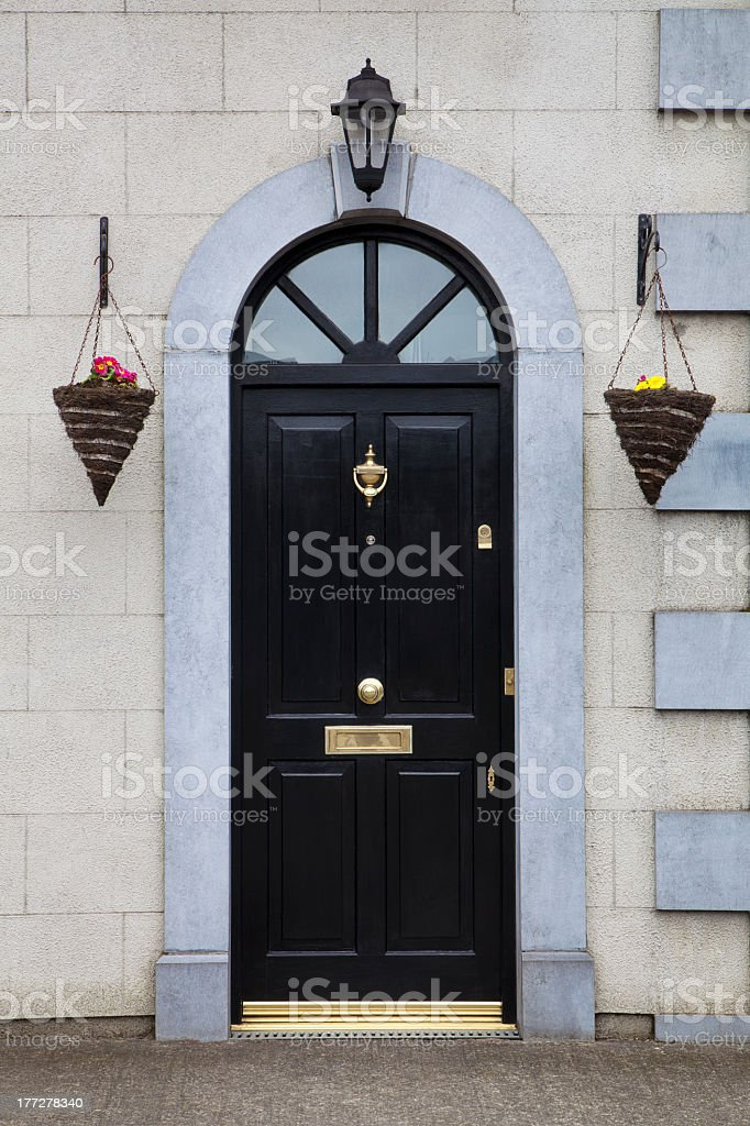 Entrance Door and flowers stock photo