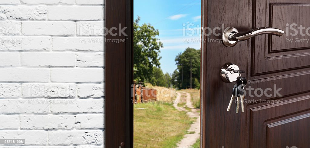 Entrance door half opened to the nature background stock photo