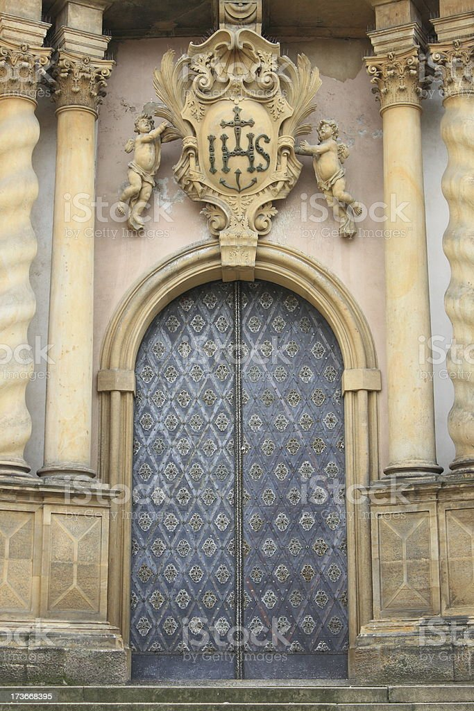 Entrance door of a baroque style church royalty-free stock photo
