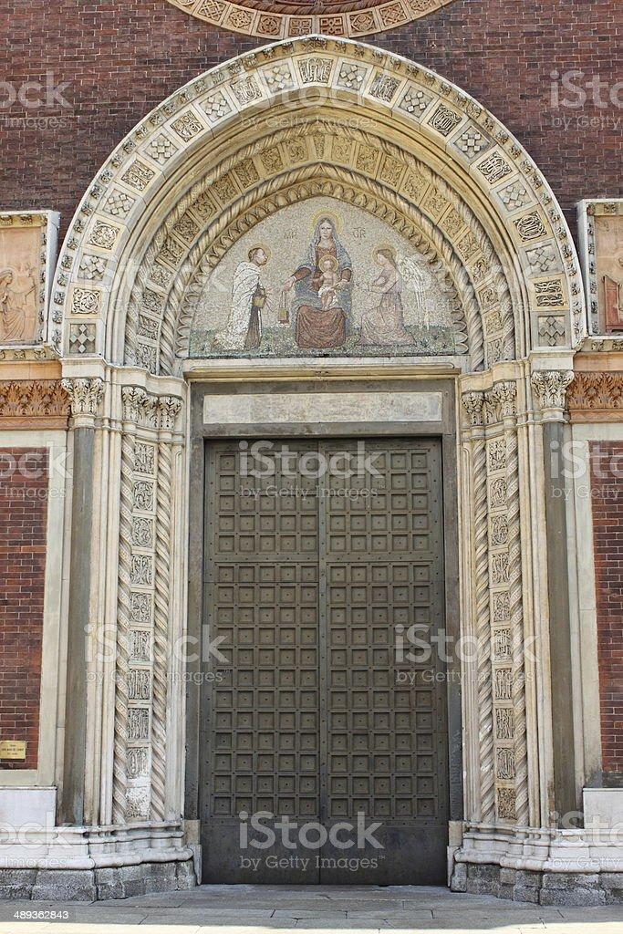 Entrance door of a romanic style church stock photo
