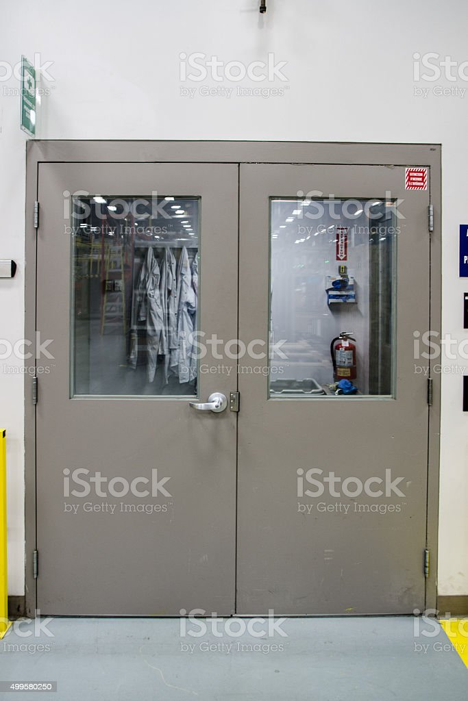 Entrance door of chemical laboratory with smocks stock photo