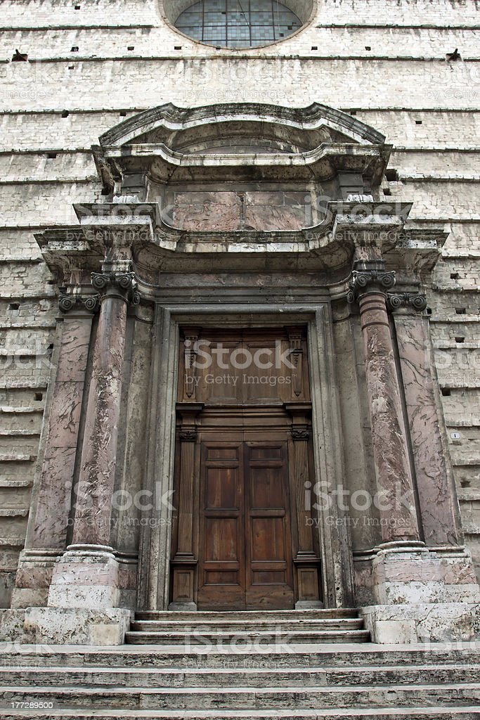 Entrance door to a historic palace in Perugia center royalty-free stock photo