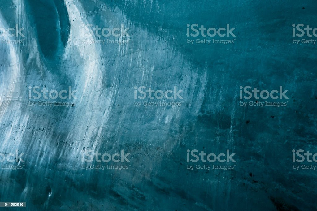 Entrance exit path of a glacier tunnel with solid ice walls and ceiling. stock photo