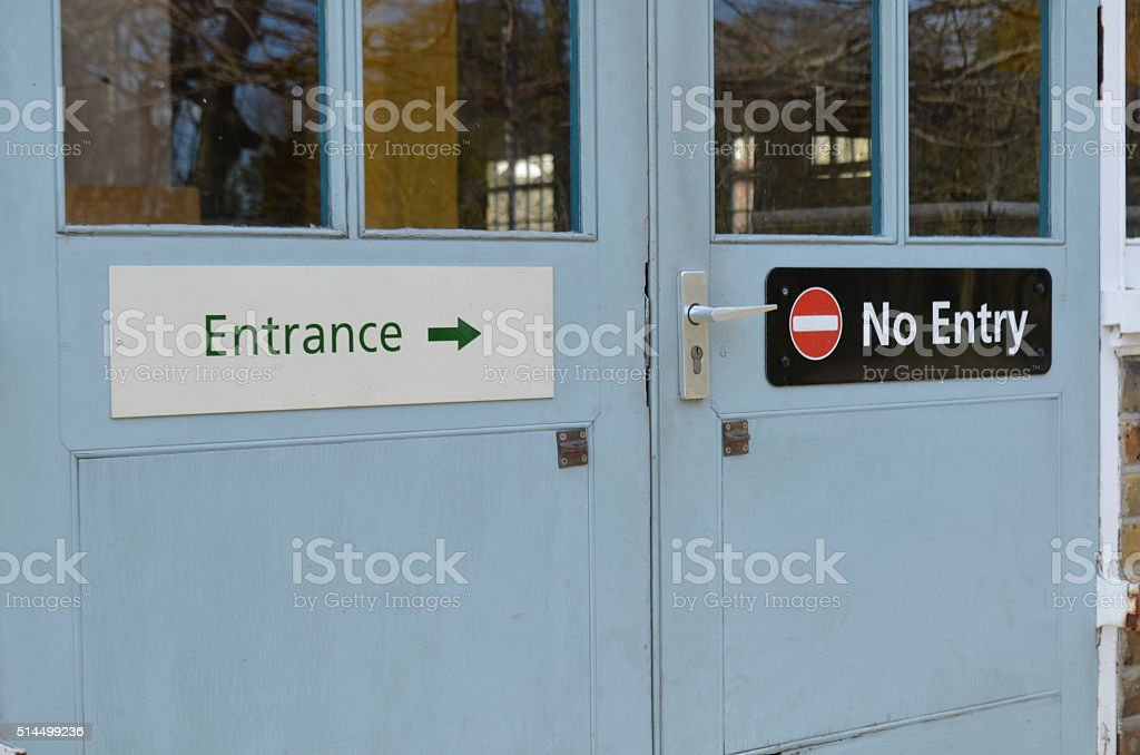 Entrance no entry door signs. stock photo