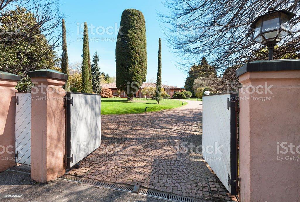 entrance of a villa, outdoors stock photo