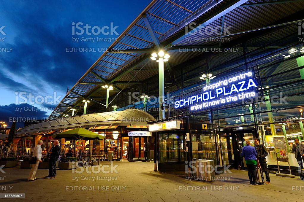 Entrance of Amsterdam Airport Schiphol in the evening stock photo