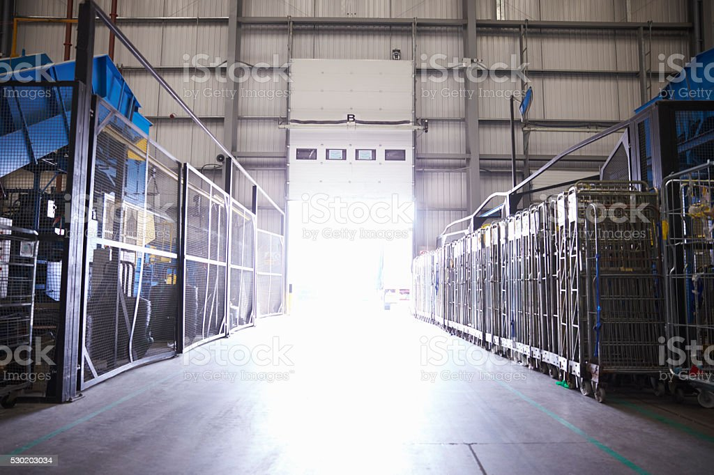 Entrance of an industrial building seen from inside, backlit stock photo