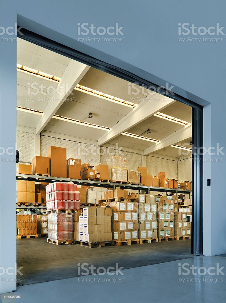 Entrance of an industrial warehouse with boxes on wooden pallets stock photo