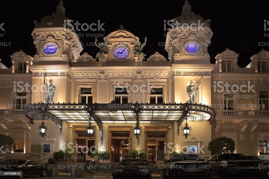 Entrance of the Monte-Carlo Casino in the principality of Monaco in the evening. stock photo
