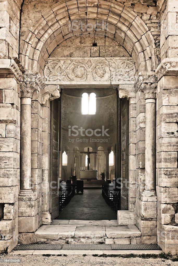 Entrance of the Sant'Antimo Church in Tuscany, Italy royalty-free stock photo