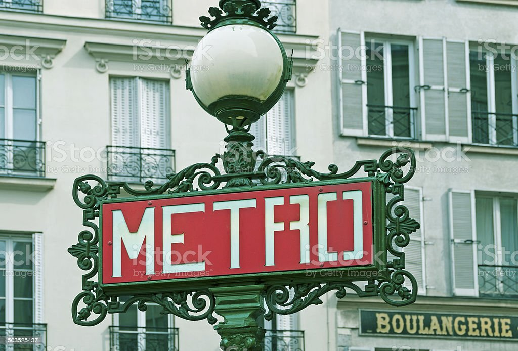Entrance sign to subway station in Paris neighborhood royalty-free stock photo