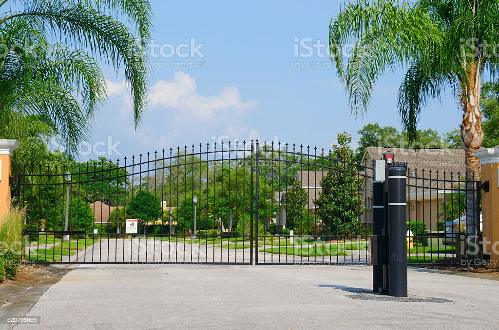 Entrance to a gated residential house community stock photo
